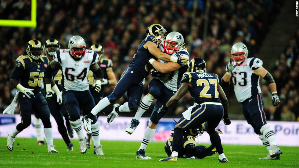Cortland Finnegan of the St. Louis Rams tackles Rob Gronkowski of the New England Patriots<br />during Sunday's game at Wembley Stadium in London.