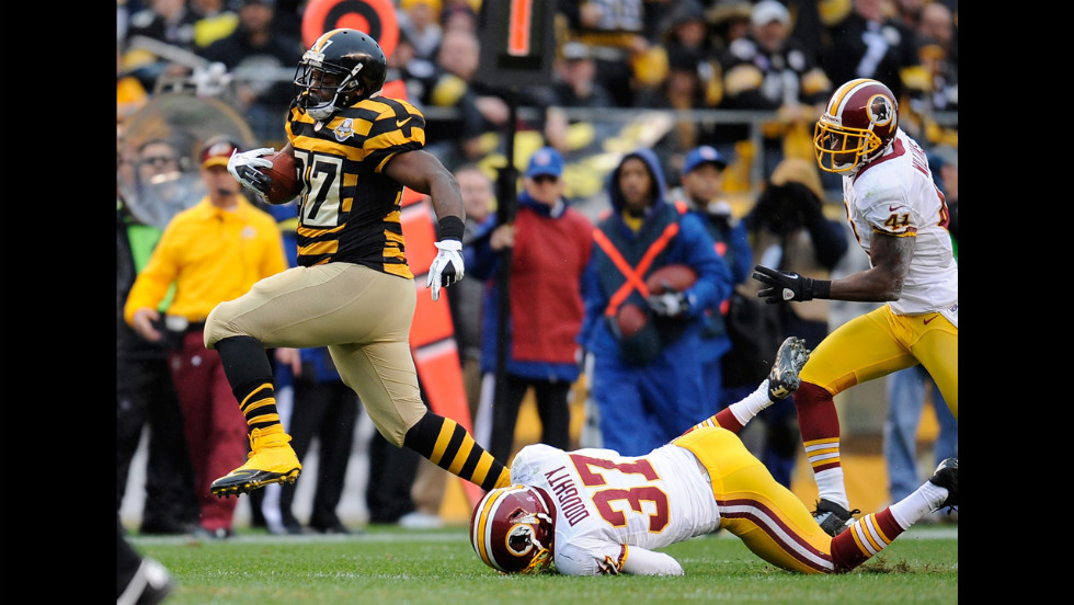 Jonathan Dwyer of the Pittsburgh Steelers avoids a tackle by Reed Doughty of the Washington Redskins on Sunday at Heinz Field in Pittsburgh.