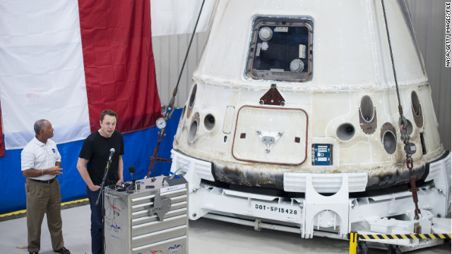 NASA'S Charles Bolden, left, and SpaceX CEO Elon Musk stand next to the Dragon capsule in June in McGregor, Texas.