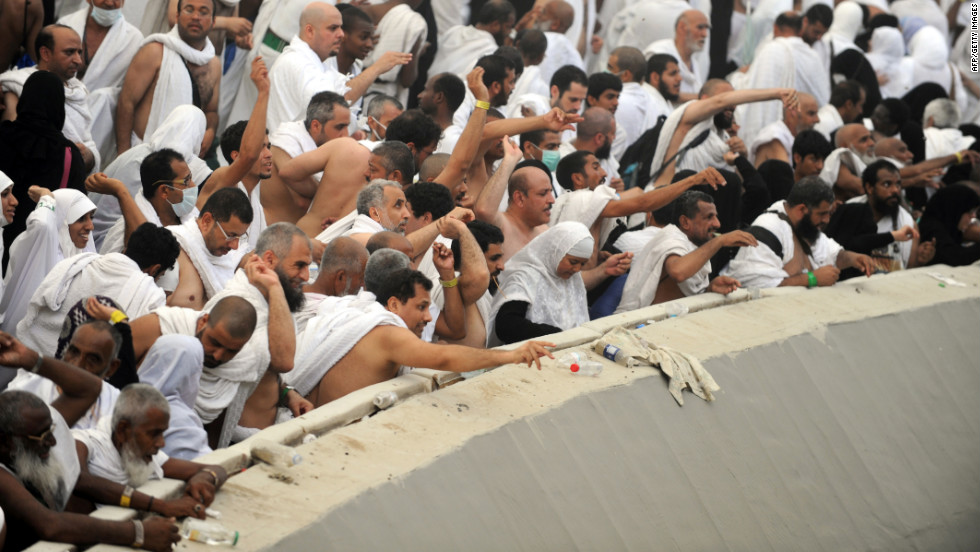 Muslim pilgrims throw pebbles at pillars during the Jamarat ritual in Mina near the holy city of Mecca, Saudi Arabia, on Friday. During the stoning of Satan ritual, pilgrims pelt pillars symbolizing the devil with stones to show their defiance.