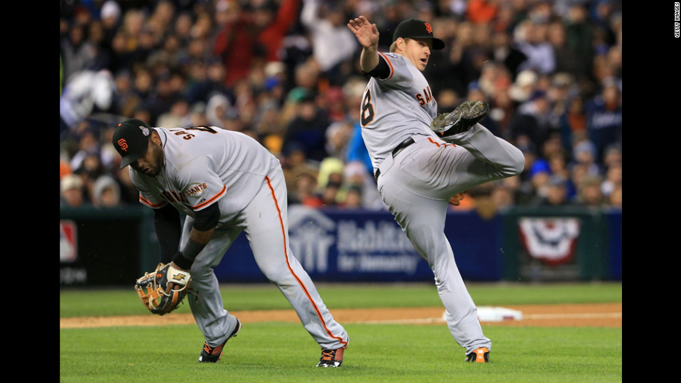 Pablo Sandoval of the Giants fields a bunt by Quintin Berry of the Tigers against Matt Cain in the third inning.