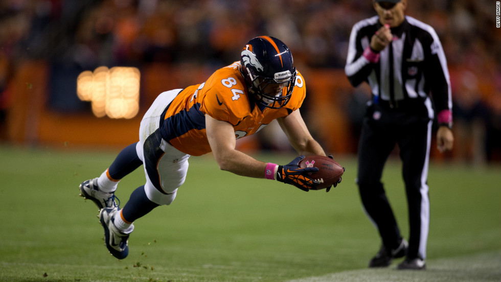 Tight end Jacob Tamme of the Denver Broncos dives for a first down during the first quarter against the New Orleans Saints at Sports Authority Field at Mile High on Sunday in Denver.