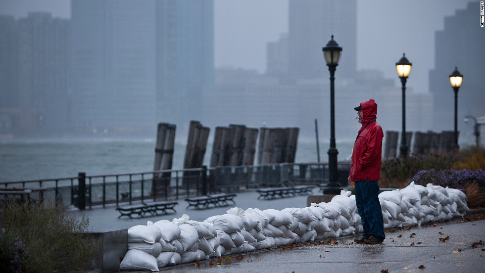A man watches the waves in New York Harbor from Battery Park on October 29. The core of Sandy's force is supposed to hit the New York area Monday night.