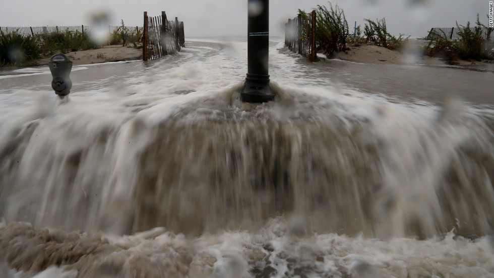 Water forced ashore ahead of the hurricane starts to flood Beach Avenue in Cape May on Monday morning.