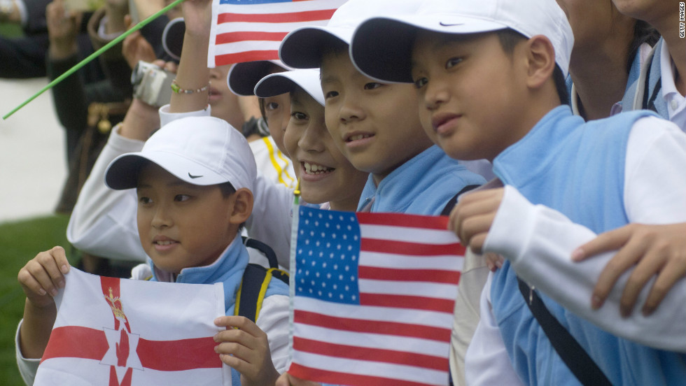 Young fans show their support for McIlroy and Woods in a country that is seen as the next great market for golf to conquer.