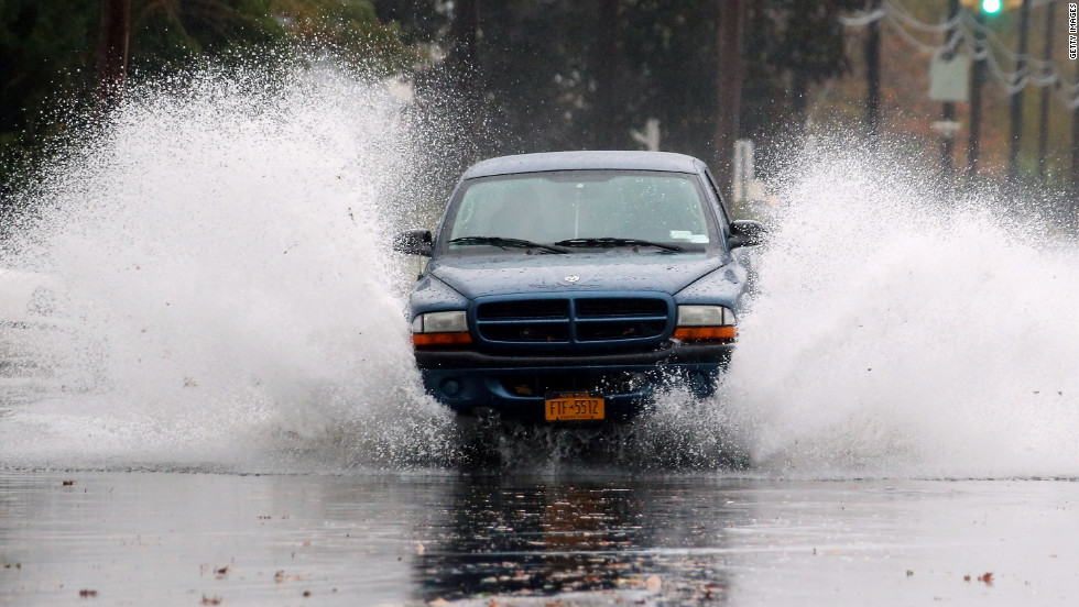 A truck moves north on South Long Beach Avenue as rising water and wind ahead of Hurricane Sandy flood the area on Monday in Freeport, New York. The storm, which threatens 50 million people in the eastern third of the United States, is expected to bring days of rain, high wind and, in places, heavy snow.