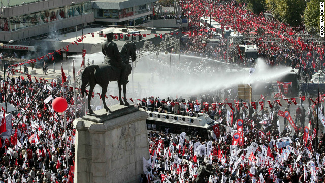 Police fire water cannons at protesters