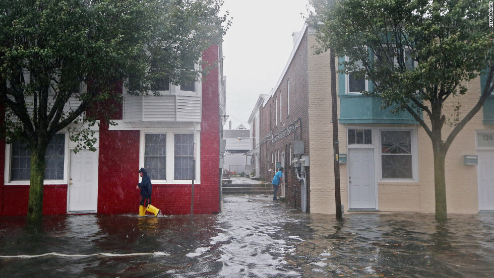 A man walks down a flooded street in Atlantic City  on Monday before the hurricane makes landfall.