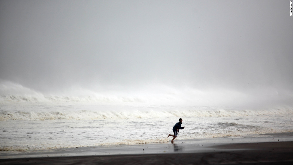 A young boy runs along Rockaway Beach in the Queens, New York, on Monday.