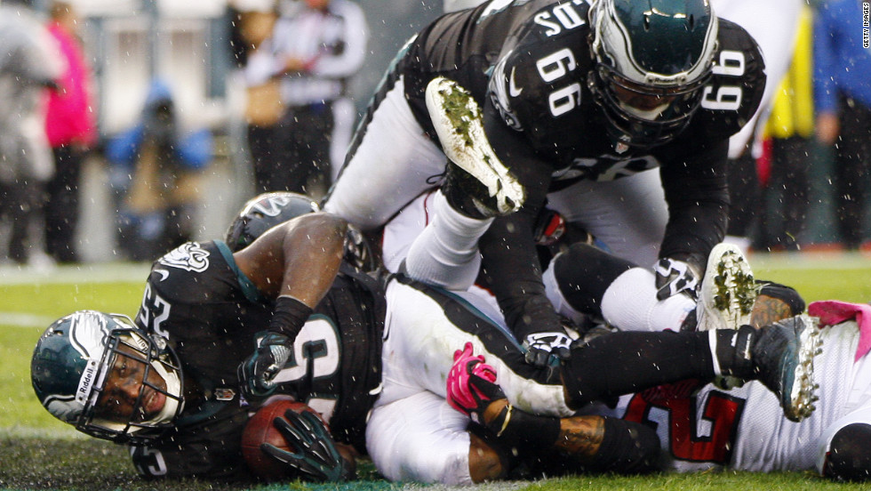 Eagles running back LeSean McCoy,  No. 25, is tackled in the end zone for a touchdown against the Atlanta Falcons during the second half on Sunday.