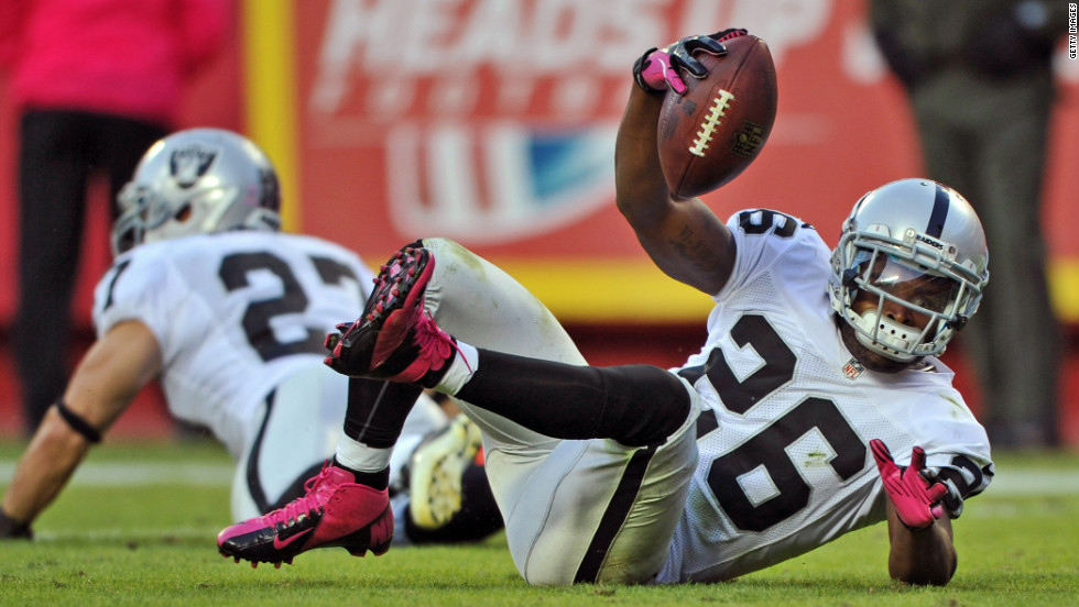 Defensive back Pat Lee of the Oakland Raiders reacts after intercepting a pass against the Kansas City Chiefs during the fourth quarter on Sunday at Arrowhead Stadium in Kansas City, Missouri.