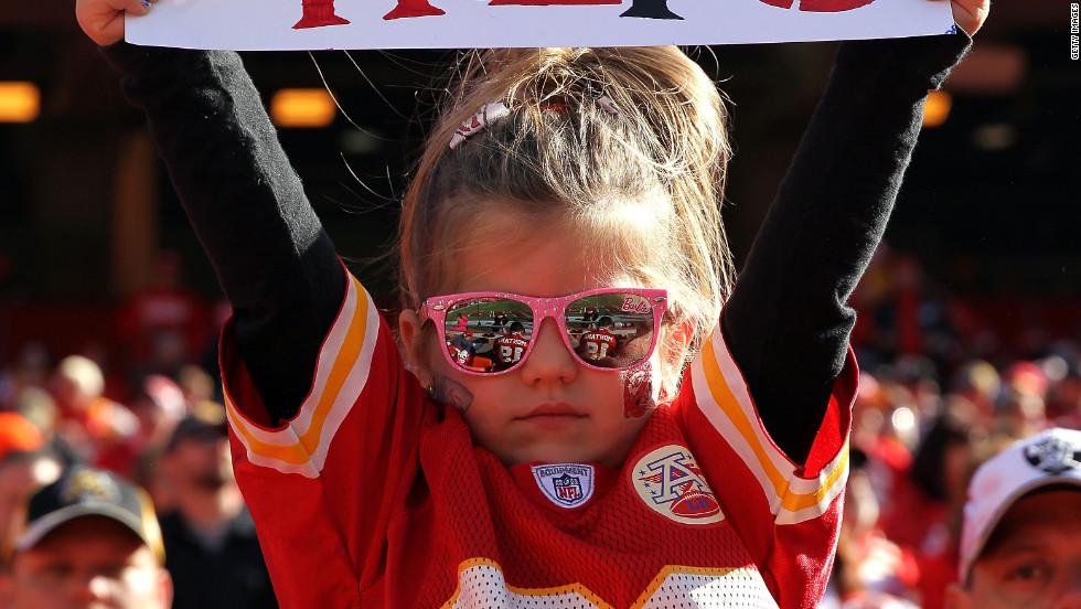 A young Chiefs fan holds a sign during the game.