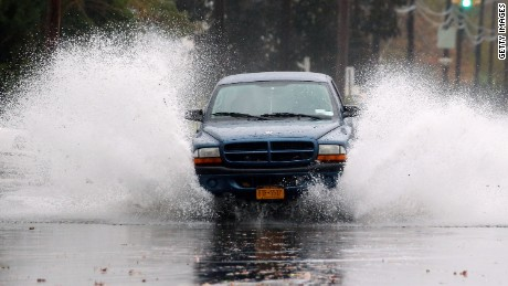 Hurricane Sandy combine to flood the area on October 29, 2012 in Freeport, New York. The storm, which threatens 50 million people in the eastern third of the U.S., is expected to bring days of rain, high winds and possibly heavy snow.