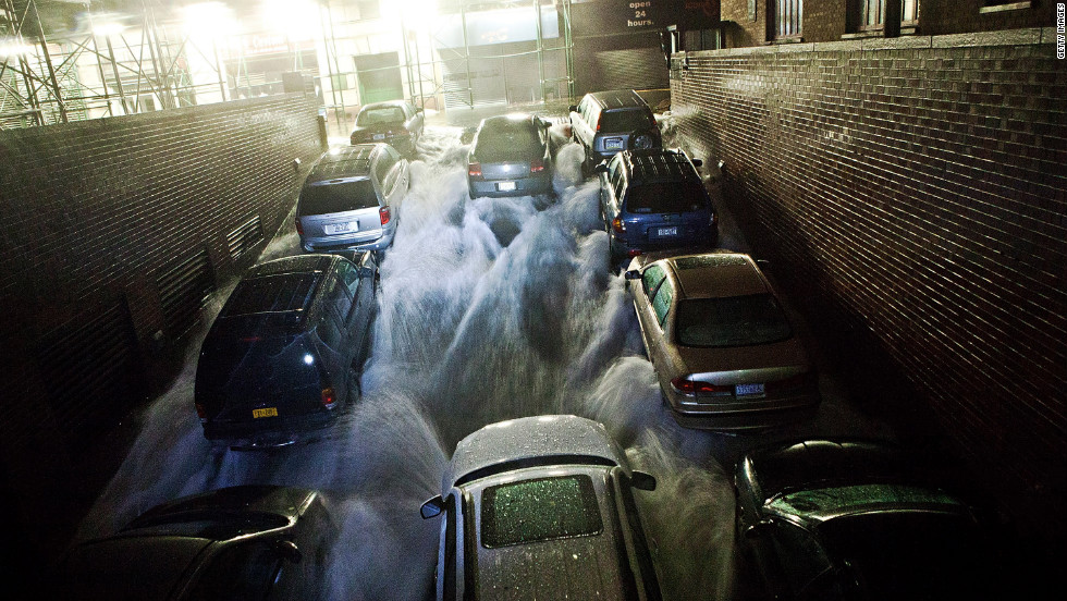 Rising water rushes into an underground parking garage in New York's financial district on Monday.