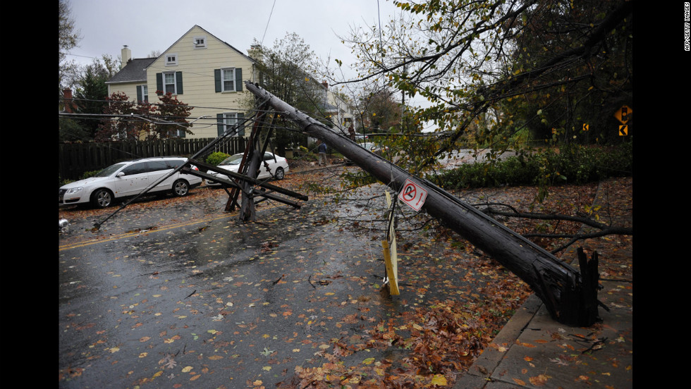 A power line knocked over by a falling tree blocks a street on Tuesday in Chevy Chase, Maryland.