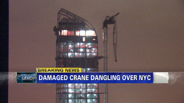 Broken crane suspended over NYC