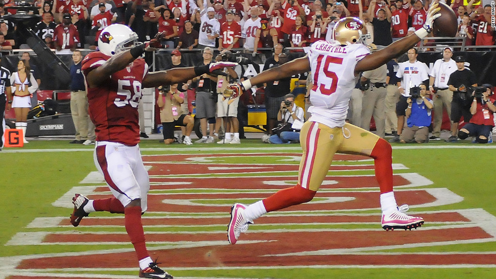 Michael Crabtree of the San Francisco 49ers scores a touchdown in front of Daryl Washington of the Arizona Cardinals on Monday.