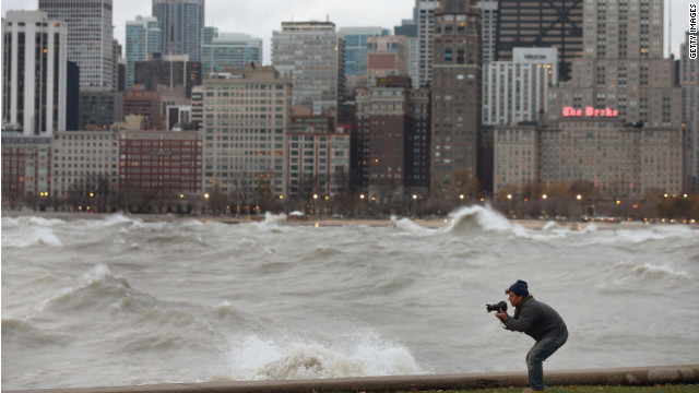 A photographer shoots waves in Lake Michigan generated from the remnants of Sandy in Chicago on Tuesday.