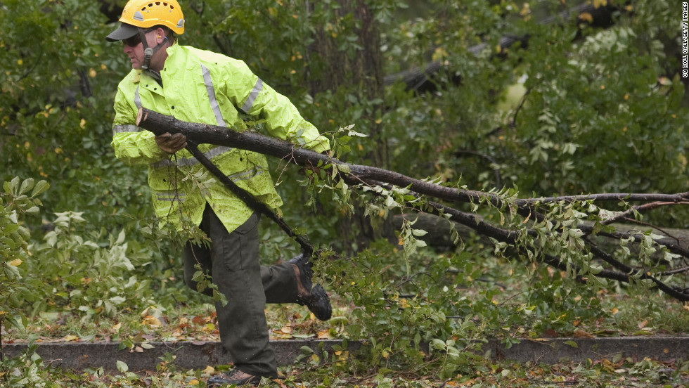 Downed trees are removed near the Korean War Veterans Memorial in Washington on Tuesday.
