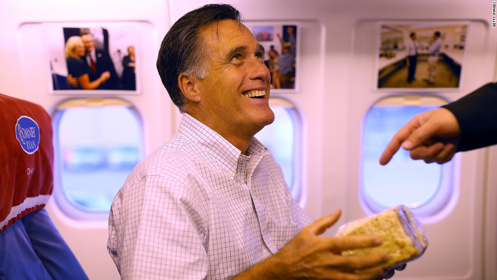 Romney holds a giant cinnamon roll on Monday en route to Dayton, Ohio.