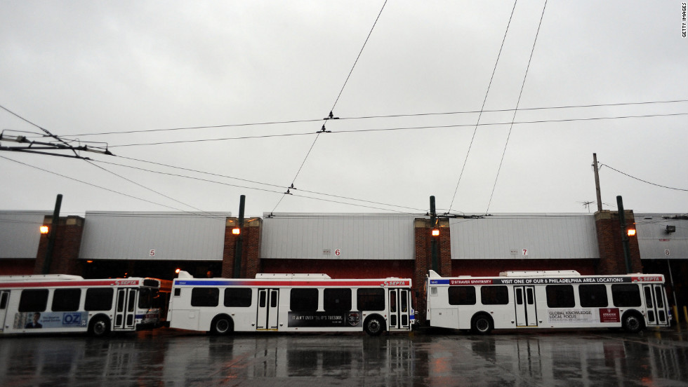 Buses at Frankford terminal in Philadelphia, Pennsylvania, sit idle after Mayor Michael Nutter ordered that all city offices be closed Monday and Tuesday due to potential damage from Sandy.