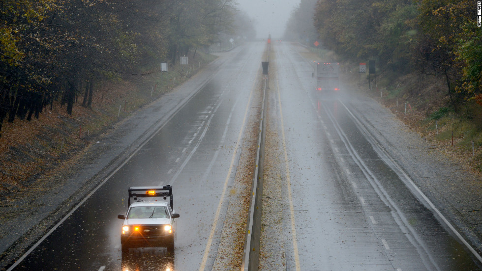 A Pennsylvania Department of Transportation truck slowly drives on the Pennsylvania Turnpike as Sandy approaches Bensalem, Pennsylvania, on Monday.