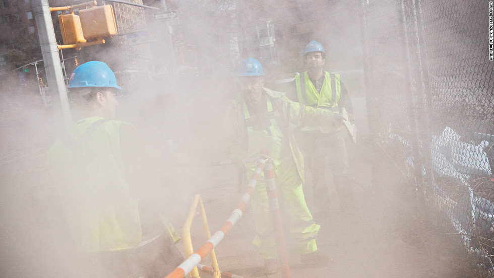 Con Edison crew members work on a steam pipe on First Avenue on Wednesday.