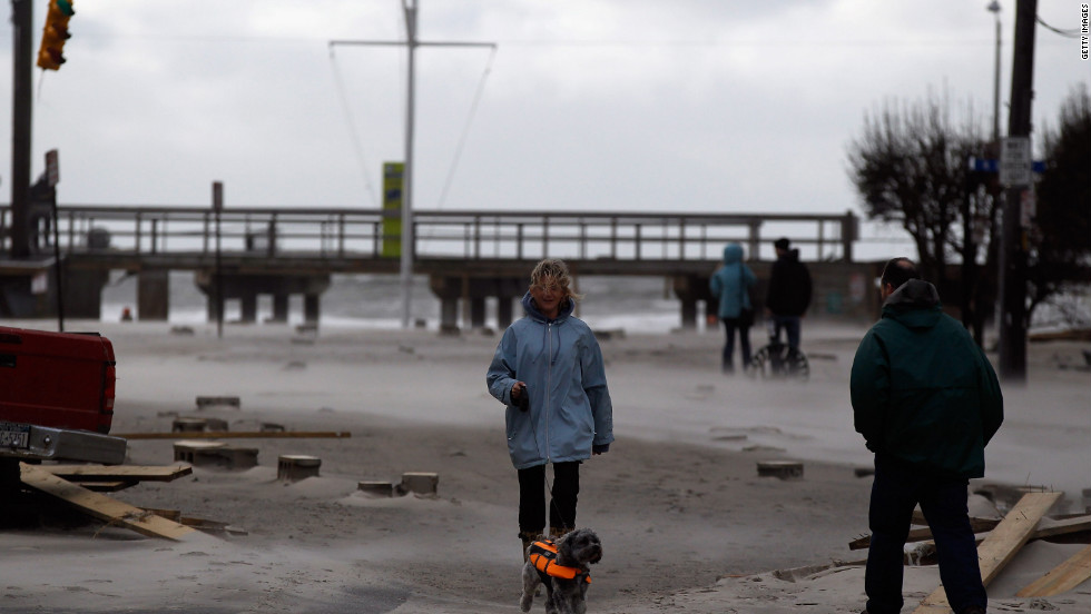 Residents of Long Beach, New York, get a look at their streets, covered by debris and beach sand, on Tuesday, October 30, the day after Hurricane Sandy hit.