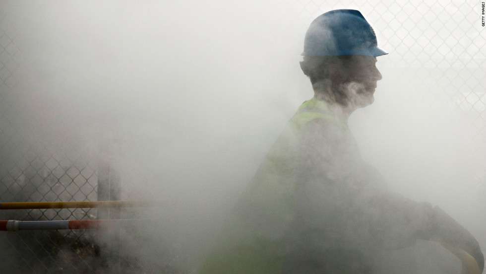 Con Edison employee John Shammah pauses while working on a steam pipe on First Avenue in New York City on Wednesday.