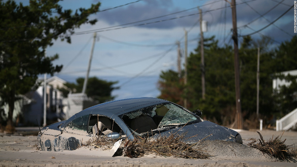 Superstorm Sandy left a car buried in sand in Long Beach Island, New Jersey.