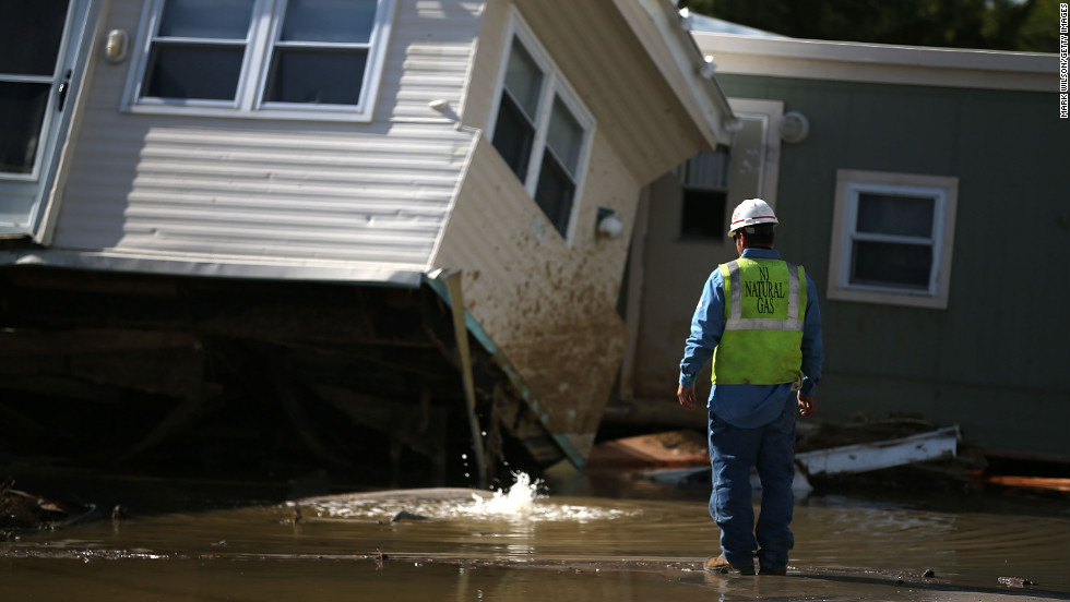New Jersey Natural Gas technician Carlos Rojas inspects a leaking gas main that is under water at a home damaged by Hurricane Sandy in Long Beach Island, New Jersey.