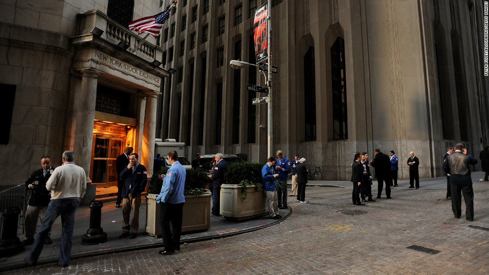 Traders stand outside of the New York Stock Exchange (NYSE) on Wednesday, October 31. U.S. equity markets resumed trading Wednesday for the first time this week after Hurricane Sandy.