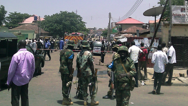 Security forces personnel pictured at the site of a blast in Kaduna on April 26, 2012.
