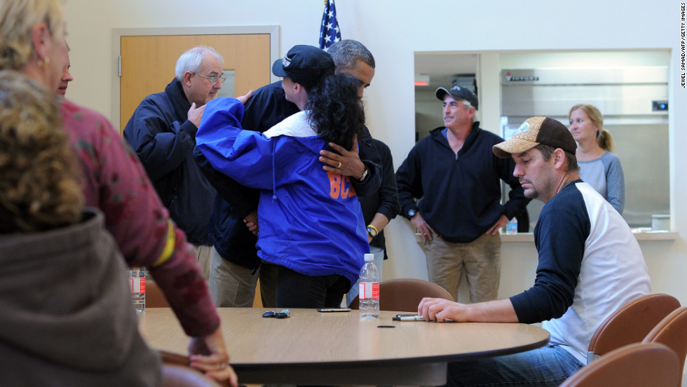 President Barack Obama greets and comforts victims of Hurricane Sandy at a shelter in Brigantine, New Jersey, on Wednesday, October 31.