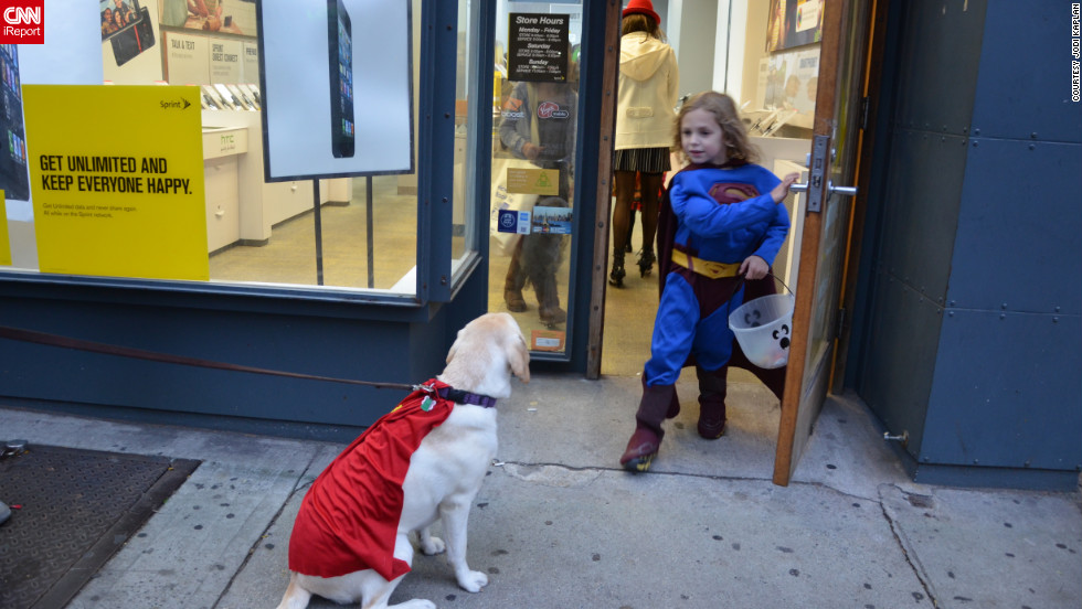 Simply attach shiny fabric to your dog's collar and voila: instant canine sidekick. iReporter Jodi Kaplan snapped this superdog while trick-or-treating in New York.