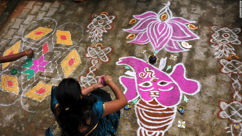 In villages the rangolis are drawn on top of  fresh cow dung. The purpose of the rangoli is to welcome guests and to encourage the Hindu goddess Lakshmi inside.
