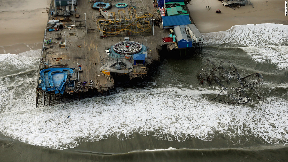 Waves break in front of an amusement park destroyed by Superstorm Sandy on Wednesday, October 31, in Seaside Heights, New Jersey. At least 56 people were killed in the storm. New Jersey suffered massive damage and power outages.