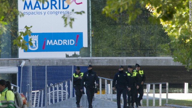 Spanish police officers pictured near the entrance of the Madrid Arena on November 1, 2012.