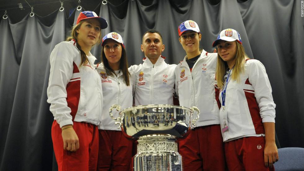 Serbia's Bojana Jovanovski, Jelena Jankovic, captain Dejan Vranes, Ana Ivanovic and Aleksandra Krunic pose for a photo with the trophy ahead of the weekend's battle with the Czech Republic.