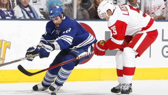 Mike Brown of the Toronto Maple Leafs strips the puck from Nicklas Lidstrom of the Detroit Red Wings during a game last January.