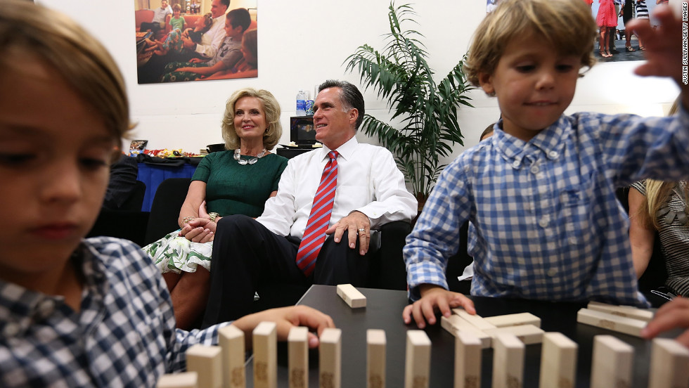 Mitt and Ann Romney sit backstage with members of their family before the final presidential debate in 2012.