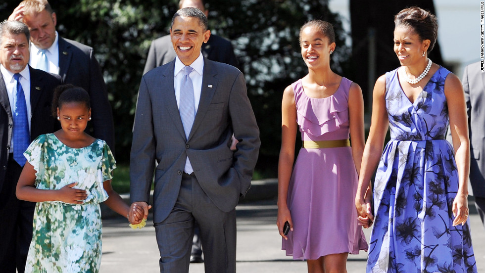 U.S. President Barack Obama walks to church with his wife, first lady Michelle Obama, and their daughters Sasha, left, and Malia, right in 2011.