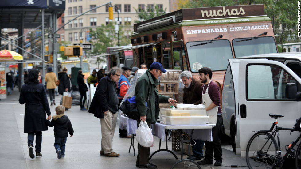 Food trucks and men selling bread and cheeses line Broadway at Union Square on Friday in New York as the city recovers from the effects of Superstorm Sandy.