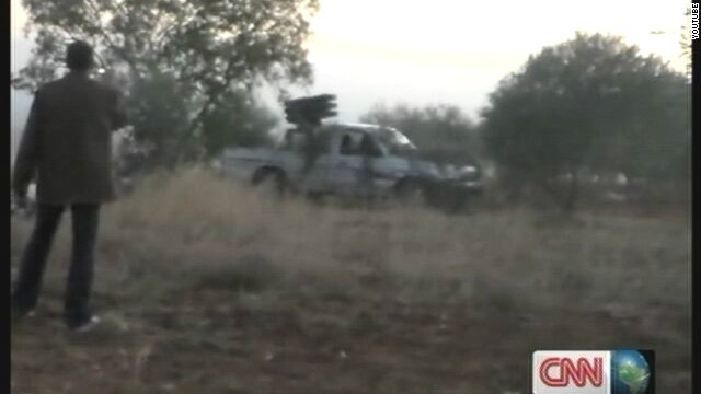 A still image from a video posted on YouTube, appearing to show Syrian rebels attacking the Taftanaz military airbase.