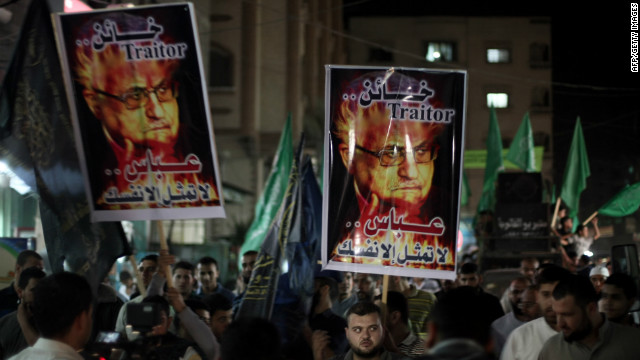 Protesters carry placards calling Palestinian Authority president Mahmud Abbas a traitor, in the Gaza Strip on November 3, 2012.