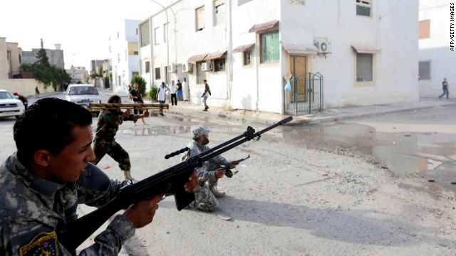 Libyan state security forces known as the National Mobile Forces fire to disband clashes between armed groups near Zawiya street in the Libyan capital, Tripoli, on November 4, 2012.