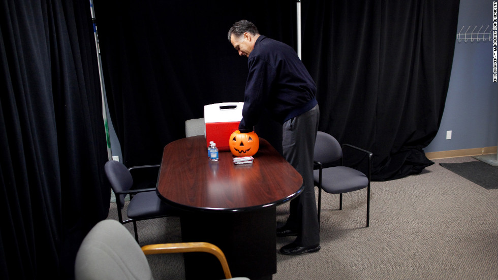 Romney grabs Halloween candy backstage before speaking in Ames, Iowa, on Oct. 26, 2012.