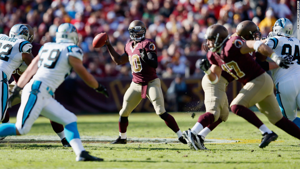 Quarterback Robert Griffin III of the Redskins throws a second quarter pass against the Panthers on Sunday.