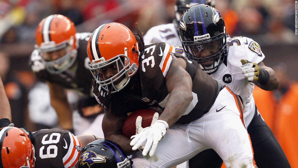 Running back Trent Richardson of the Browns runs the ball as he is hit by defenders Arthur Jones and Dannell Ellerbe of the Ravens on Sunday.
