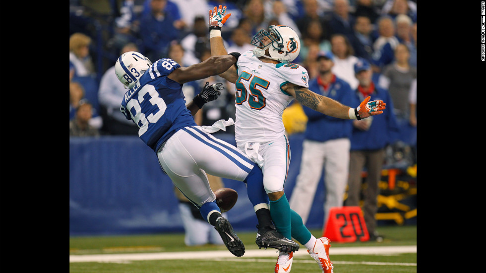 Koa Misi of the Dolphins defends a first quarter pass against Dwayne Allen of the Colts but was called for pass interference on Sunday.